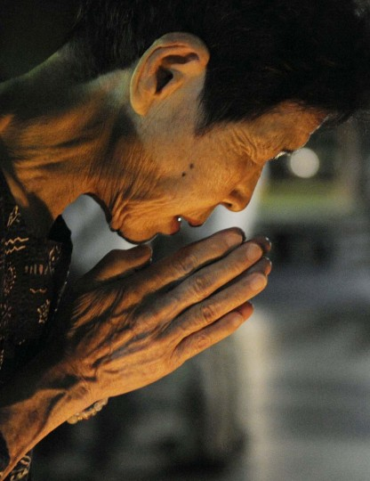 A woman prays for the victims of the 1945 atomic bombing, in the Peace Memorial Park in Hiroshima August 6, 2012, on the 67th anniversary of the world's first atomic bombing on the city. (Kyodo/Reuters)