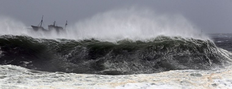 A Chinese fishing boat is seen near high waves off a port in Seogwipo on Jeju Island, south of Seoul in this August 27, 2012 picture. Typhoon Bolaven, with winds of up to 170 kmh (106 mph), buffeted South Korea's west coast on Tuesday, leaving four dead and a dozen people missing after two Chinese fishing vessels capsized. (Kim Ho-Chon/Yonhap/Reuters)