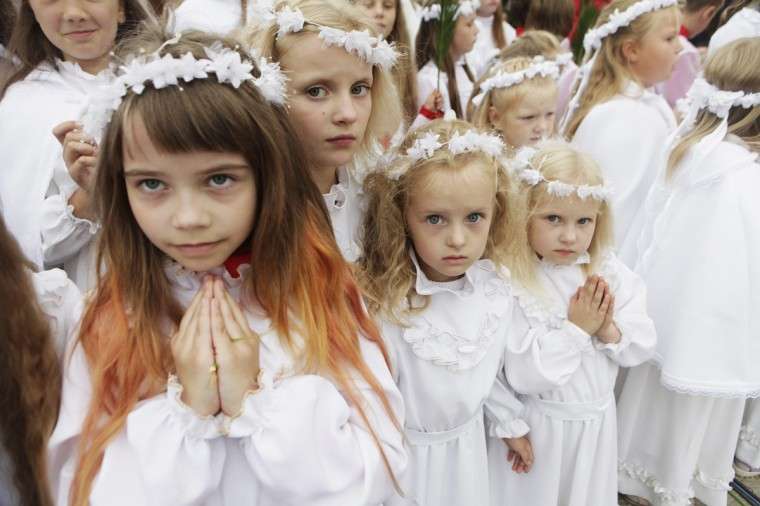 Girls pray during the celebration of the Assumption of the Virgin Mary in Aglona, about 250 km (155 miles) east of Riga. Thousands of worshippers from Latvia, Lithuania, Poland and Belarus assembled for the event at Aglona Basilica this year, local media reported. (Ints Kalnins/Reuters)