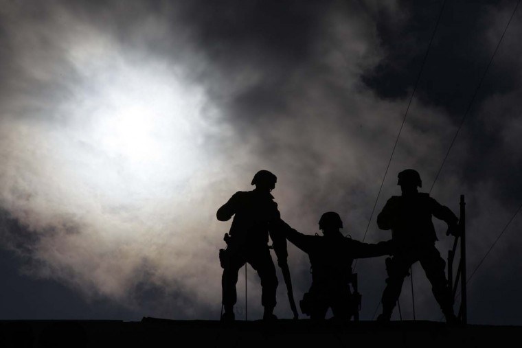 Policemen prepare to rappel during a demonstration of K9 unit and police techniques at the Secretary of Public Security in the municipality of Guadalupe August 13, 2012. (Daniel Becerril/Reuters)