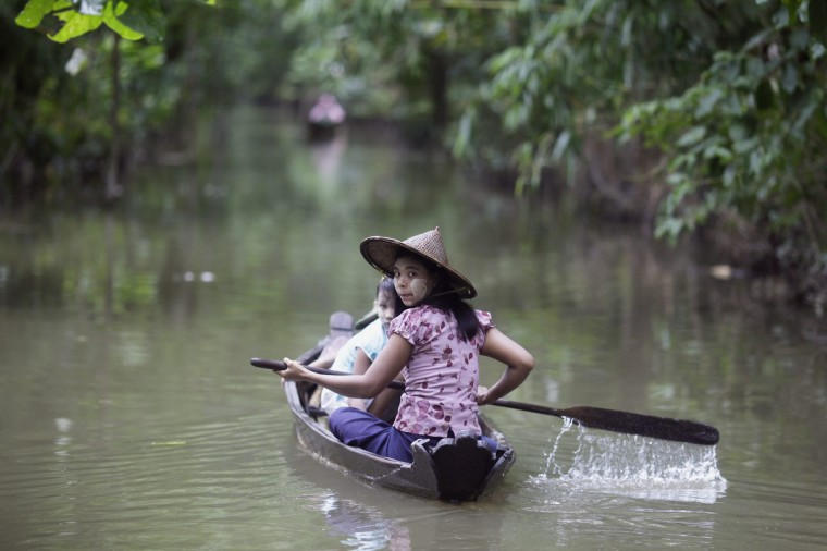 A woman rows a small boat on a flood affected street in the Kyune Kone township delta area, Irrawaddy Division. More than 700 villages and over 200,000 acres (80,940 hectares) of rice fields were flooded, according to local media reports. (Soe Zeya Tun/Reuters)