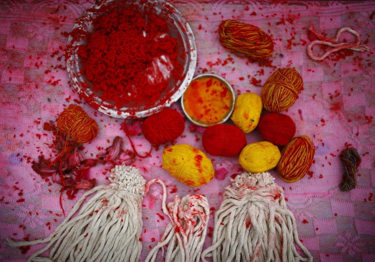 "Sacred threads and ""tika"", coloured powder and rice grains used as a blessing, are pictured during the Janai Purnima, or Sacred Thread, Festival at the Pashupatinath temple in Kathmandu August 2, 2012. (Navesh Chitrakar/Reuters)"