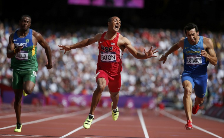Ashton Eaton of the U.S. wins in the men's decathlon 100m heat next to Brazil's Luiz Alberto de Araujo (L) and Ukraine's Oleksiy Kasyanov (R) during the London 2012 Olympic Games at the Olympic Stadium. (Lucy Nicholson/Reuters)