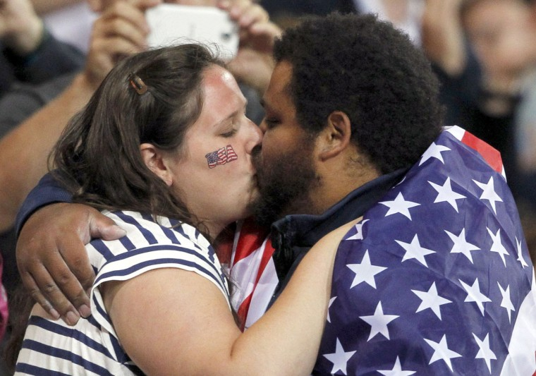 Reese Hoffa of the U.S kisses his wife Renata (L) as he celebrates after placing third in the men's shot put final at the London 2012 Olympic Games in the Olympic Stadium August 3, 2012. Poland's Tomasz Majewski finished first ahead of Germany's David Storl who placed second and Hoffa who finished third. (Mark Blinch/Reuters)