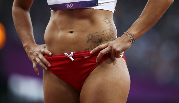 The tattoo of Lebanon's Gretta Taslakian is seen during her women's 200m round 1 heat at the London 2012 Olympic Games at the Olympic Stadium August 6, 2012. (Lucy Nicholson/Reuters)