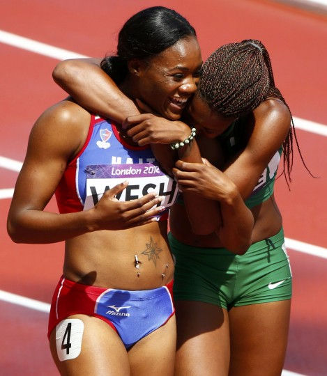 First placed Regina George (R) of Nigeria hugs third placed Marlena Wesh of Haiti after heat 3 of the women's 400m during the London 2012 Olympic Games at the Olympic Stadium August 3, 2012. (David Gray/Reuters)