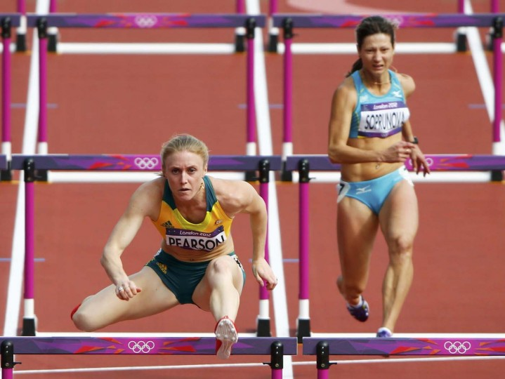 Australia's Sally Pearson (L) competes with Kazakhstan's Anastasiya Soprunova during their women's 100m hurdles round 1 heat during the London 2012 Olympic Games at the Olympic Stadium August 6, 2012. (David Gray/Reuters)