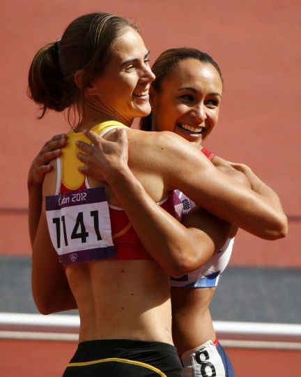 Britain's Jessica Ennis (R) hugs Belgium's Sara Aerts after their women's heptathlon 100m hurdles heat at the London 2012 Olympic Games at the Olympic Stadium August 3, 2012. (David Gray/Reuters)