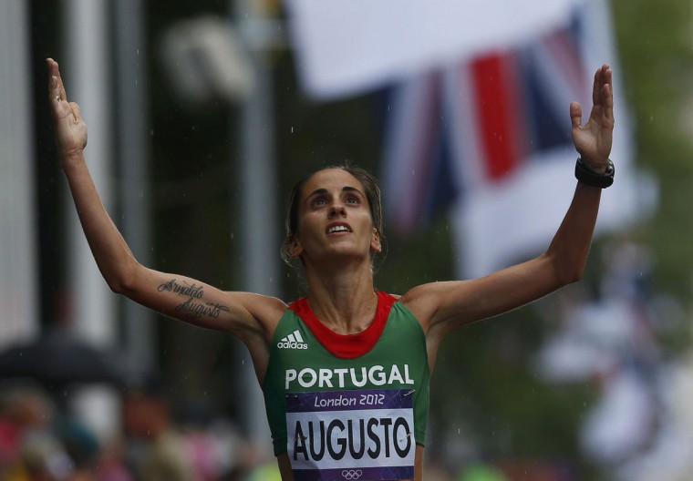 Portugal's Jessica Augusto looks up after finishing the women's marathon final at the London 2012 Olympic Games at The Mall August 5, 2012. (Eddie Keogh/Reuters)