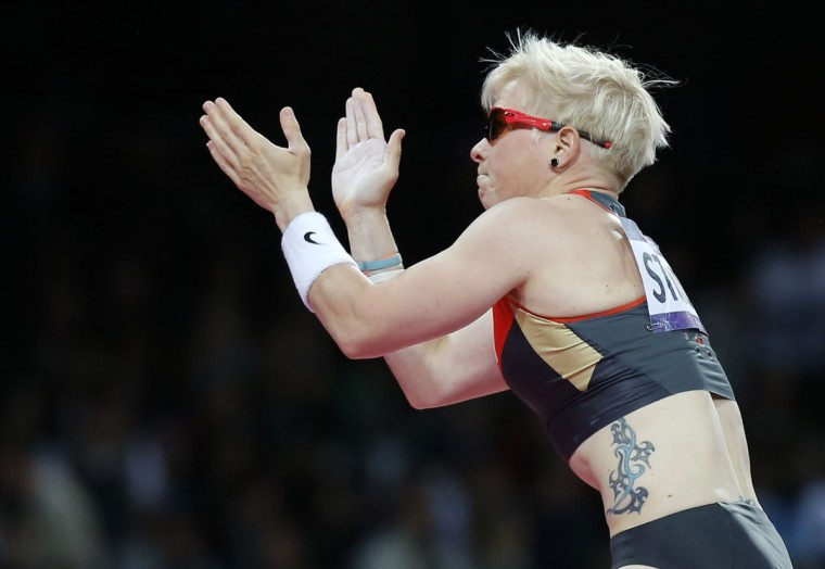 Germany's Martina Strutz claps during the women's pole vault final at the London 2012 Olympic Games at the Olympic Stadium August 6, 2012. (Phil Noble/Reuters)