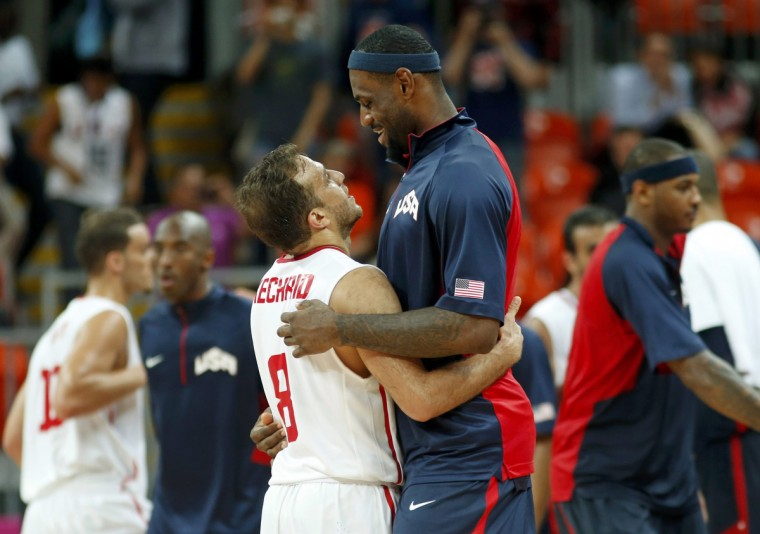 Lebron James (R) of the U.S. hugs Tunisia's Marouan Kechrid after their game at the men's preliminary round Group A basketball match at the Basketball Arena during the London 2012 Olympic Games. (Mike Segar/Reuters)