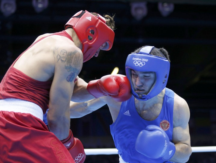 Ukraine's Oleksandr Usyk (L) fights against Russia's Artur Beterbiev during their Men's Heavy (91kg) Quarterfinal boxing match during the London 2012 Olympic Games August 5, 2012. (Murad Sezer/Reuters)