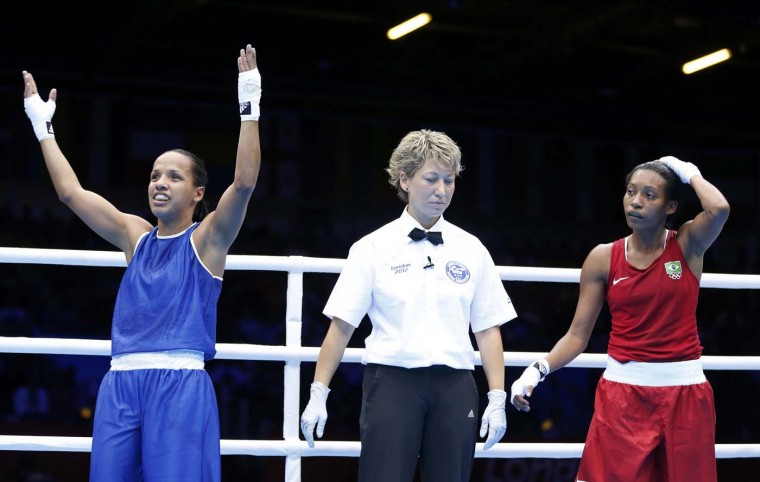 Venezuela's Karlha Magliocco (L) celebrates after defeating Brazil's Erica Matos in their Women's Fly (51kg) Round of 16 boxing match during the London 2012 Olympic Games August 5, 2012. (Murad Sezer/Reuters)