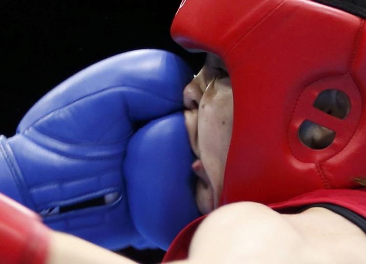 Ireland's Katie Taylor (R) fights Tajikistan's Mavzuna Chorieva during their Women's Light (60kg) semi-final boxing match at the London Olympic Games. (Damir Sagolj/Reuters)