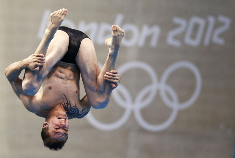 France's Matthieu Rosset performs a dive during the men's 3m springboard preliminary round at the London 2012 Olympic Games at the Aquatics Centre August 6, 2012. (Jorge Silva/Reuters)