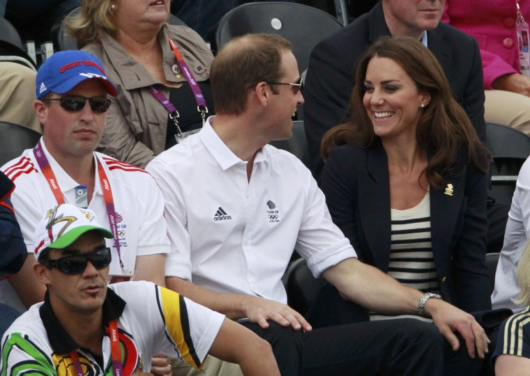 Britain's Prince William (C) and his wife Catherine, Duchess of Cambridge, smile next to Peter Phillips (L) during the Eventing Jumping equestrian event at the London 2012 Olympic Games in Greenwich Park, July 31, 2012. (Luke Macgregor/Reuters)