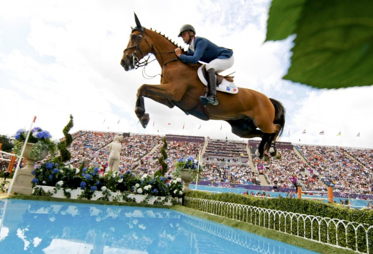 Olivier Guillon of France riding Lord de Theize performs during the equestrian individual jumping final at the London 2012 Olympic Games in Greenwich Park. (Mike Hutchings/Reuters)