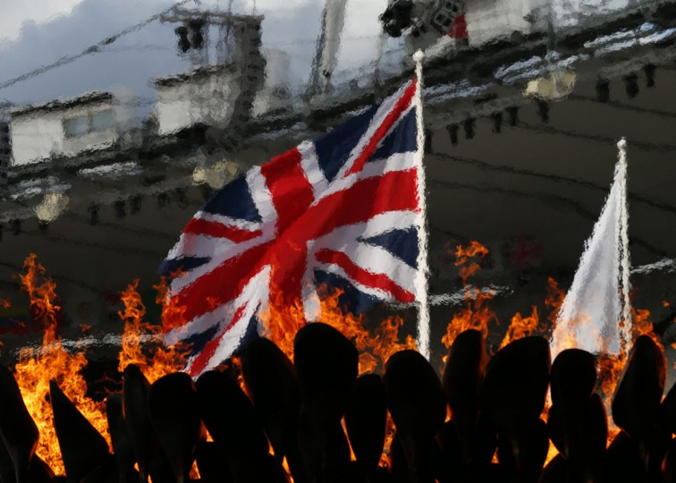 A Union flag, commonly known as a Union Jack, is seen through the heat haze of the London 2012 Olympic Cauldron at the Olympic Stadium in London August 2, 2012. (Eddie Keogh/Reuters)