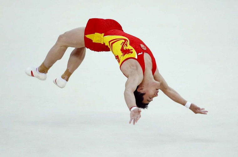 Zou Kai of China competes in the men's gymnastics floor exercise final in the North Greenwich Arena during the London 2012 Olympic Games August 5, 2012. (Mike Blake/Reuters)