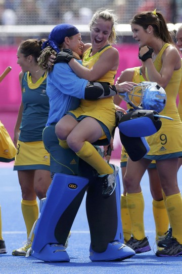 Australia's goalkeeper Toni Cronk (C) and Emily Smith celebrate after their women's Group B hockey match against the U.S. at the London 2012 Olympic Games at the Riverbank Arena on the Olympic Park August 2, 2012. (Cathal McNaughton/Reuters)