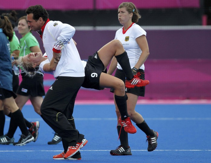 Germany's Kristina Hillmann celebrates with a team member after defeating South Africa during their women's Group B hockey match at the London 2012 Olympic Games at the Riverbank Arena on the Olympic Park August 2, 2012. (Chris Helgren/Reuters)