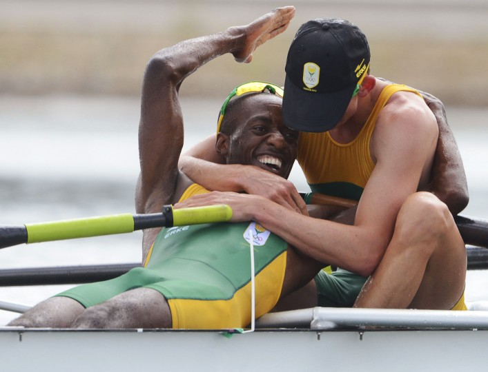 South Africa's John Smith (R) and Sizwe Ndlovu celebrate after winning the gold medal in the men's lightweight four final rowing event event during the London 2012 Olympic Games at Eton Dorney August 2, 2012. (Damien Meyer/Pool/Reuters)