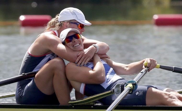Britain's Katherine Grainger and Anna Watkins (L) celebrate after winning the women's double sculls final A at the London 2012 Olympic Games in Eton Dorney August 3, 2012. (Jim Young/Reuters)