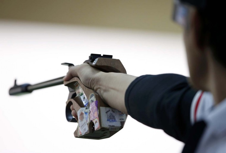 Japan's Tomoyuki Matsuda takes aim during the men's 50m pistol qualification round at the Royal Artillery Barracks during the London 2012 Olympic Games August 5, 2012. (Jorge Silva/Reuters)