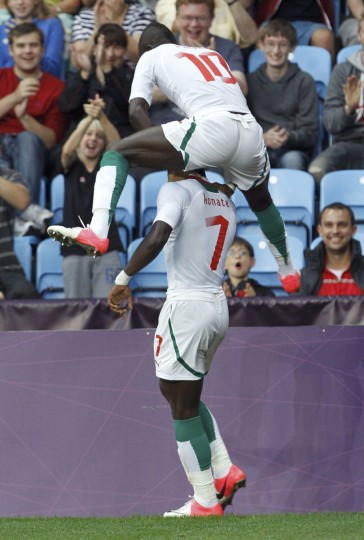 Senegal's Moussa Konate (L) celebrates his goal with teammate Sadio Mane during their men's Group A football match against UAE at the London 2012 Olympic Games in the City of Coventry stadium August 1, 2012. (Alessandro Garofalo/Reuters)