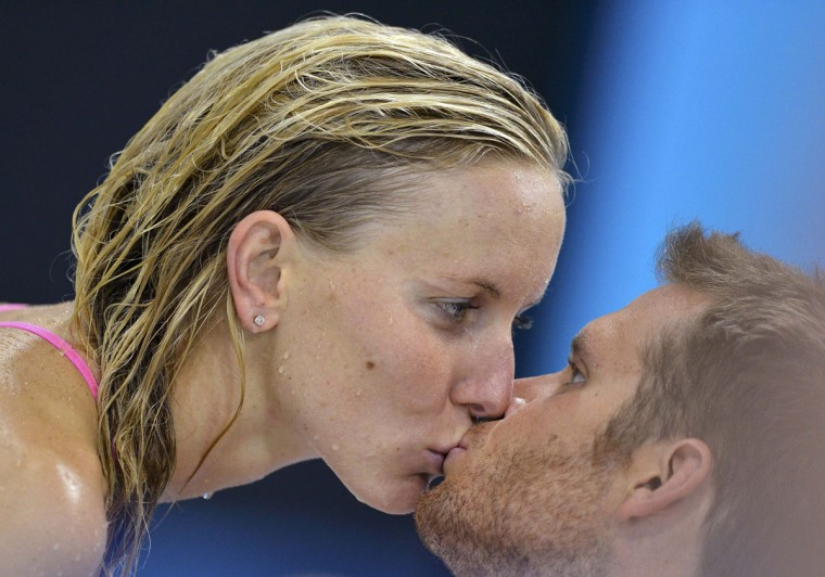 Jessica Hardy of the U.S. kisses her boyfriend Dominik Meichtry of Switzerland during a training session at the Aquatics Centre before the start of the London 2012 Olympic Games July 27, 2012. (Toby Melville/Reuters)