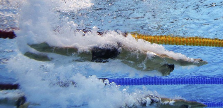 Michael Phelps of the U.S. is seen underwater as he starts to swim the butterfly leg of the men's 4x100m medley relay final during the London 2012 Olympic Games at the Aquatics Centre August 4, 2012. The U.S. team of Matthew Grevers, Brendan Hansen, Michael Phelps and Nathan Adrian won the gold in the event. (Michael Dalder/Reuters)