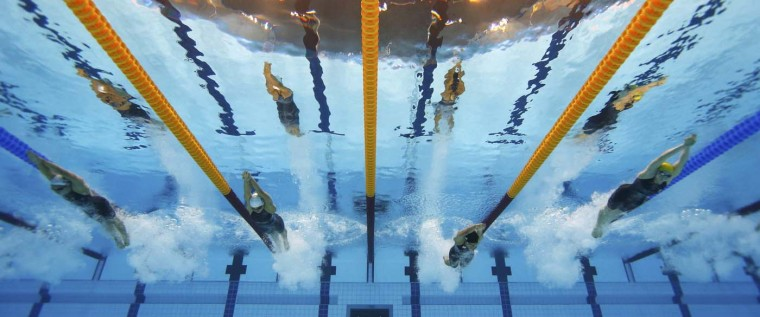 (From L to R) Spain's Judit Ignacio Sorribes and Mireia Belmonte Garcia, Japan's Natsumi Hoshi and Australia's Jessicah Schipper swim in the women's 200m butterfly heats during the London 2012 Olympic Games at the Aquatics Centre July 31, 2012. (Michael Dalde/Reuters)