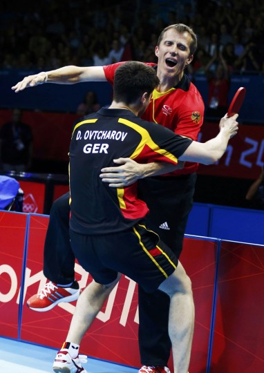 Germany's Dimitrij Ovtcharov celebrates with his coach Jorg Rosskopf after defeating Taiwan's Chuang Chih-yuan in their men's singles bronze medal table tennis match at the ExCel venue during the London 2012 Olympic Games August 2, 2012. (Grigory Dukor/Reuters)