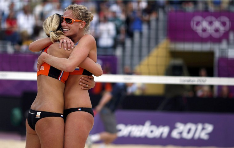 The Netherlands' Sanne Keizer (R) and Marleen van Iersel celebrate after they defeated Argentina's Maria Virginia Zonta and Ana Gallay during their women's preliminary round beach volleyball match at Horse Guards Parade during the London 2012 Olympic Games August 2, 2012. (Marcelo del Pozo/Reuters)