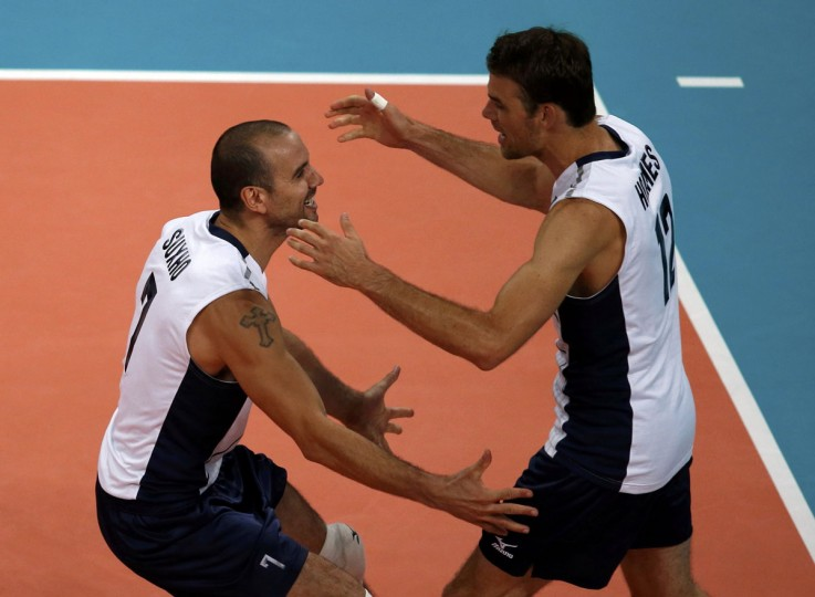 Donald Suxho (L) and Russell Holmes of the U.S. celebrate a point against Brazil during their men's Group B volleyball match at Earls Court during the London 2012 Olympic Games August 2, 2012. (Ivan Alvarado/Reuters)