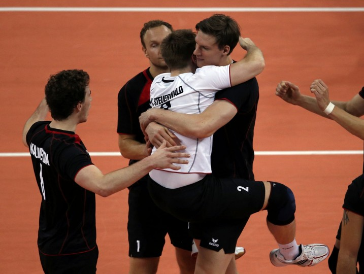 Germany's players celebrate a point against Serbia during their men's Group B volleyball match at Earls Court during the London 2012 Olympic Games August 2, 2012. (Ivan Alvarado/Reuters)