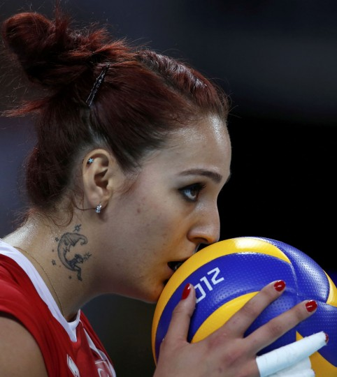 Turkey's Bahar Toksoy kisses the ball as she prepares to serve against South Korea during their women's Group B volleyball match at Earls Court during the London 2012 Olympic Games August 3, 2012. (Ivan Alvarado/Reuters)