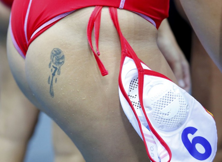Tattoo is seen on Spain's Andrea Blas Martinez during their women's water polo quarterfinal round against Great Britain at the Water Polo Arena during the London 2012 Olympic Games August 5, 2012. (Laszlo Balogh/Reuters)