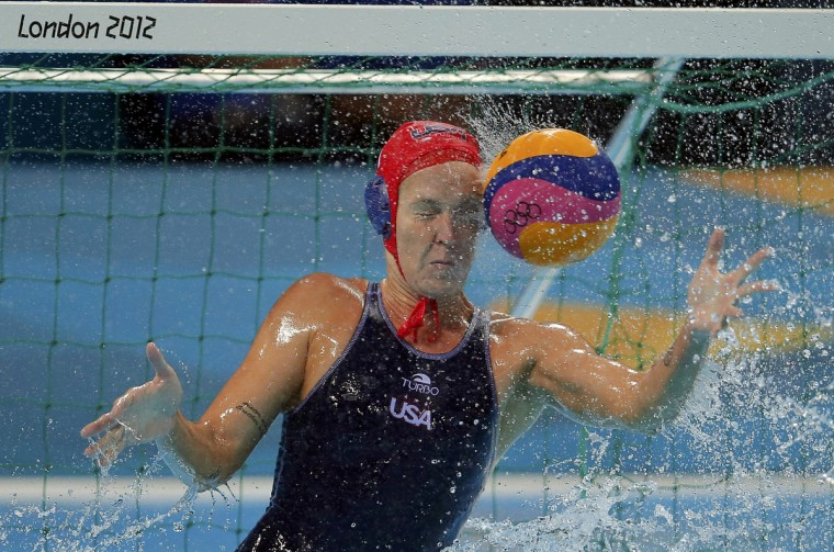 U.S. goalkeeper Betsey Armstrong is hit by the ball during their women's preliminary round Group A water polo match against Spain during the London 2012 Olympic Games at the Water Polo Arena. (Laszlo Balogh/Reuters)