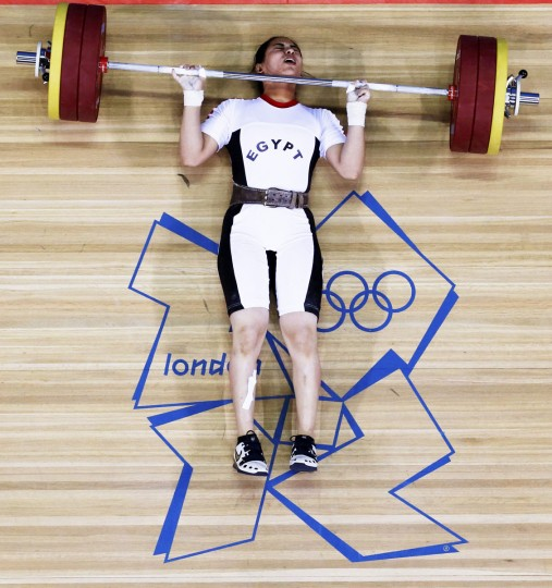 Egypt's Khalil K Abir Abdelrahman falls after failed attempt on the women's 75Kg group A weightlifting competition at the ExCel venue at the London 2012 Olympic Games. (Dominic Ebenbichler/Reuters)
