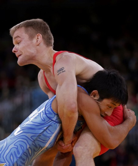 Denmark's Haakan Erik Nyblom (in red) fights with Japan's Kohei Hasegawa on the Men's 55Kg Greco-Roman wrestling qualification at the ExCel venue during the London 2012 Olympic Games August 5, 2012. (Toru Hanai/Reuters)