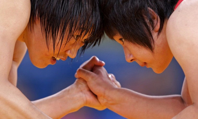 China's Ruixue Jing (L) fights with North Korea's Un Gyong Choe on the Women's 63Kg Greco-Roman wrestling at the ExCel venue during the London 2012 Olympic Games. (Toru Hanai/Reuters)