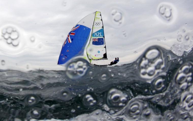 New Zealand's Peter Burling and Blair Tuke sail before the fifth race of the men's 49er sailing class at the London 2012 Olympic Games in Weymouth and Portland, southern England. (Pascal Lauener/Reuters)