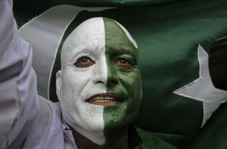 A man, with his face painted depicting the colours of the Pakistan national flag, attends a ceremony to mark the country's Independence Day at the Wagah border crossing with India on the outskirts of Lahore. Pakistan gained independence from British rule in 1947. (Mohsin Raza/Reuters)