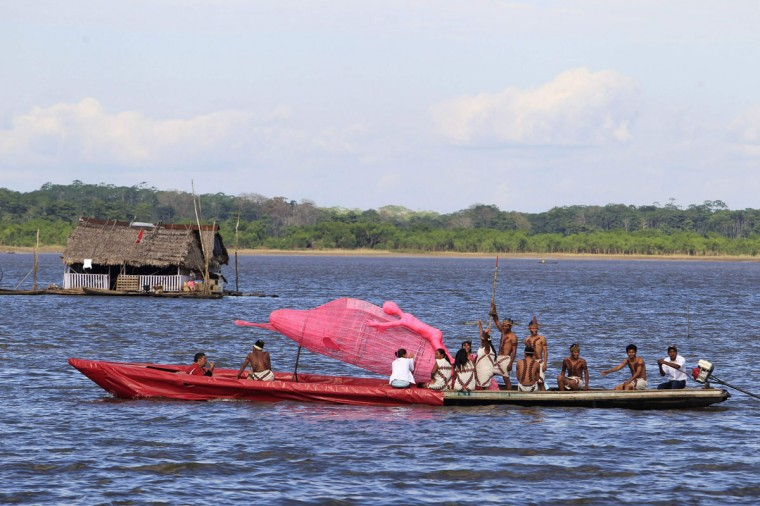 Indigenous people participate in a festival inaugurating the Amazon River as one of the seven natural wonders of the world in Iquitos, Peru on August 13, 2012. The Amazon River made it to the list of winners in a global contest conducted by the New Seven Wonders Foundation, according to local media. (Enrique Castro-Mendivil/Reuters)