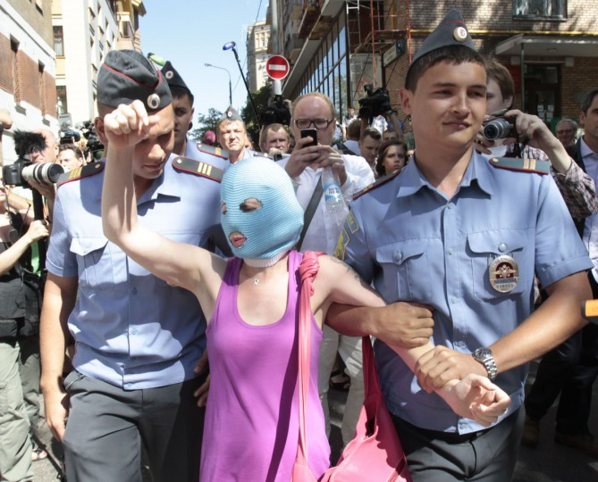 "MOSCOW, RUSSIA - AUGUST 8: A supporter of the female punk band ""Pussy Riot"" is detained by police outside a court in Moscow August 8, 2012. (Sergei Karpukhin/Reuters)"