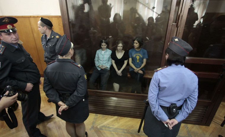 "MOSCOW, RUSSIA - AUGUST 17: Members of the female punk band ""Pussy Riot"" (R-L) Nadezhda Tolokonnikova, Maria Alyokhina and Yekaterina Samutsevich sit in a glass-walled cage during a court hearing in Moscow, August 17, 2012. A Russian judge on Friday found three women from the punk band Pussy Riot guilty of hooliganism motivated by religious hatred for staging an anti-Kremlin protest on the altar of Moscow's main cathedral. (Maxim Shemetov/Reuters)"