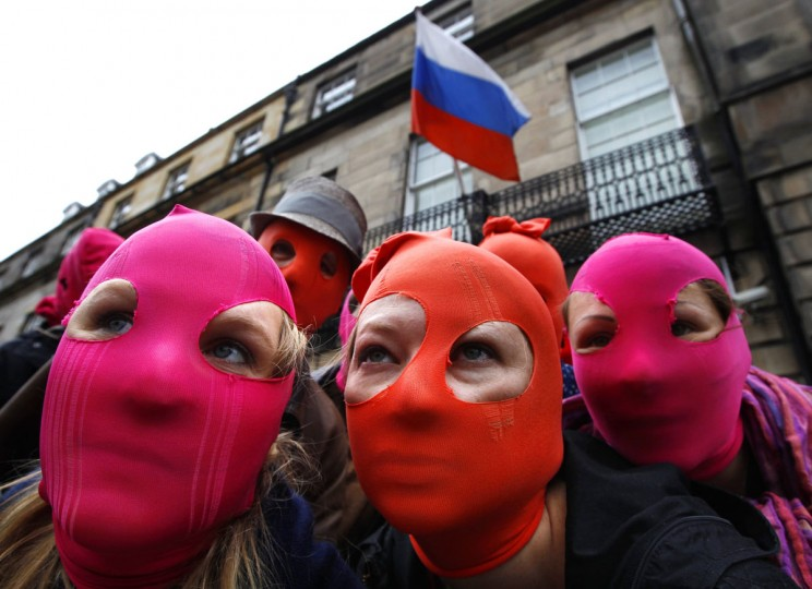 EDINBURGH, SCOTLAND - AUGUST 17: Protestors gather outside the Russian Consulate General building during a demonstration of support for the female Russian female punk band Pussy Riot in Edinburgh, Scotland August 17, 2012. A Russian judge found three women from the punk band Pussy Riot guilty of hooliganism motivated by religious hatred on Friday for staging an anti-Kremlin protest on the altar of Moscow's main Russian Orthodox church. (David Moir/Reuters)