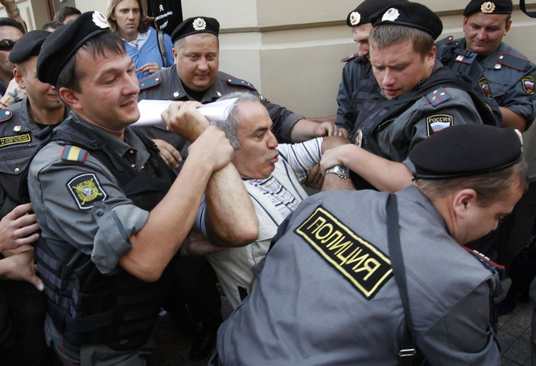 "MOSCOW, RUSSIA - AUGUST 17: Police detain former world chess champion and opposition leader Garry Kasparov (C) during the trial of the female punk band ""Pussy Riot"" outside a court building in Moscow, August 17, 2012. (Tatyana Makeyeva/Reuters)"