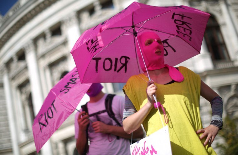 VIENNA, AUSTRIA - AUGUST 17: Supporters of the Russian feminist punk band Pussy Riot attend a gathering in Vienna, August 17, 2012. (Lisi Niesner/Reuters)